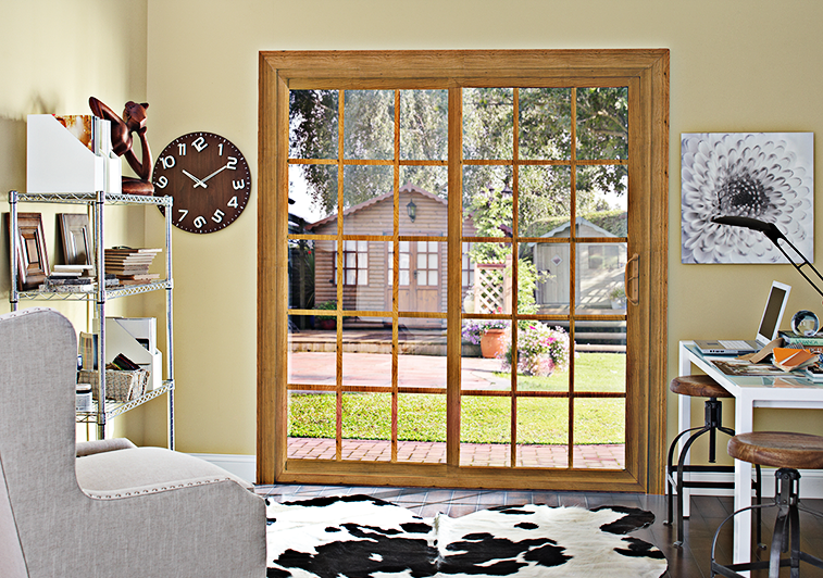 Interior view of sliding glass patio door with wood grid