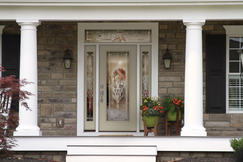 Exterior view of tan premium entrance door with glass insert,  side lights and transom windowsansumd ba