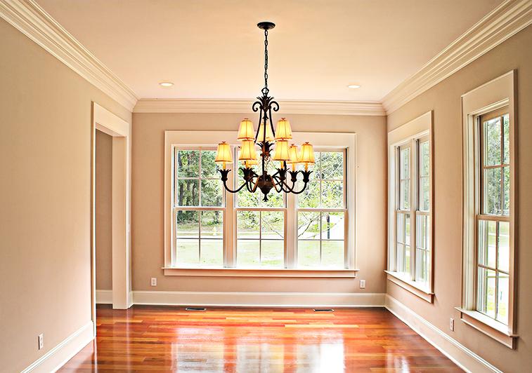Interior of sunlit, window filled dining area