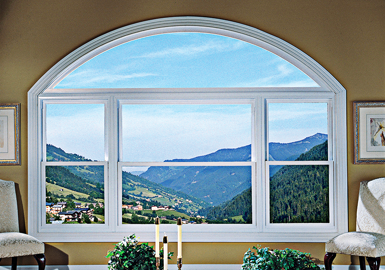 Interior view of set of three windows with large arched window on top