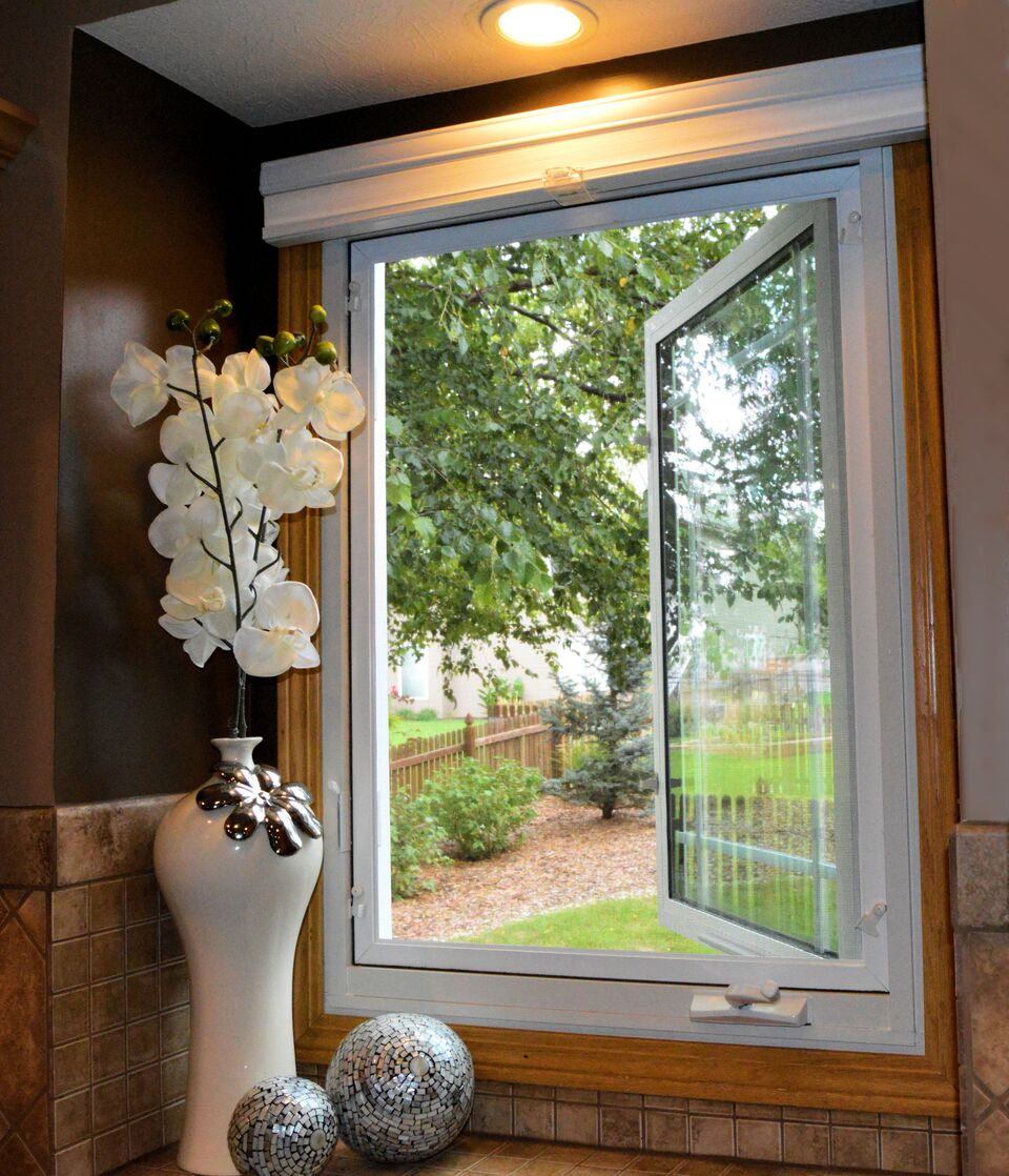 Interior of bathroom featuring an open casement window